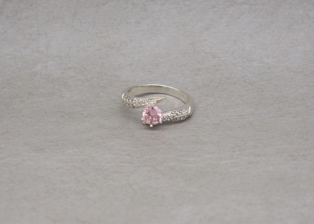 Sterling silver bypass ring with pink & clear stones