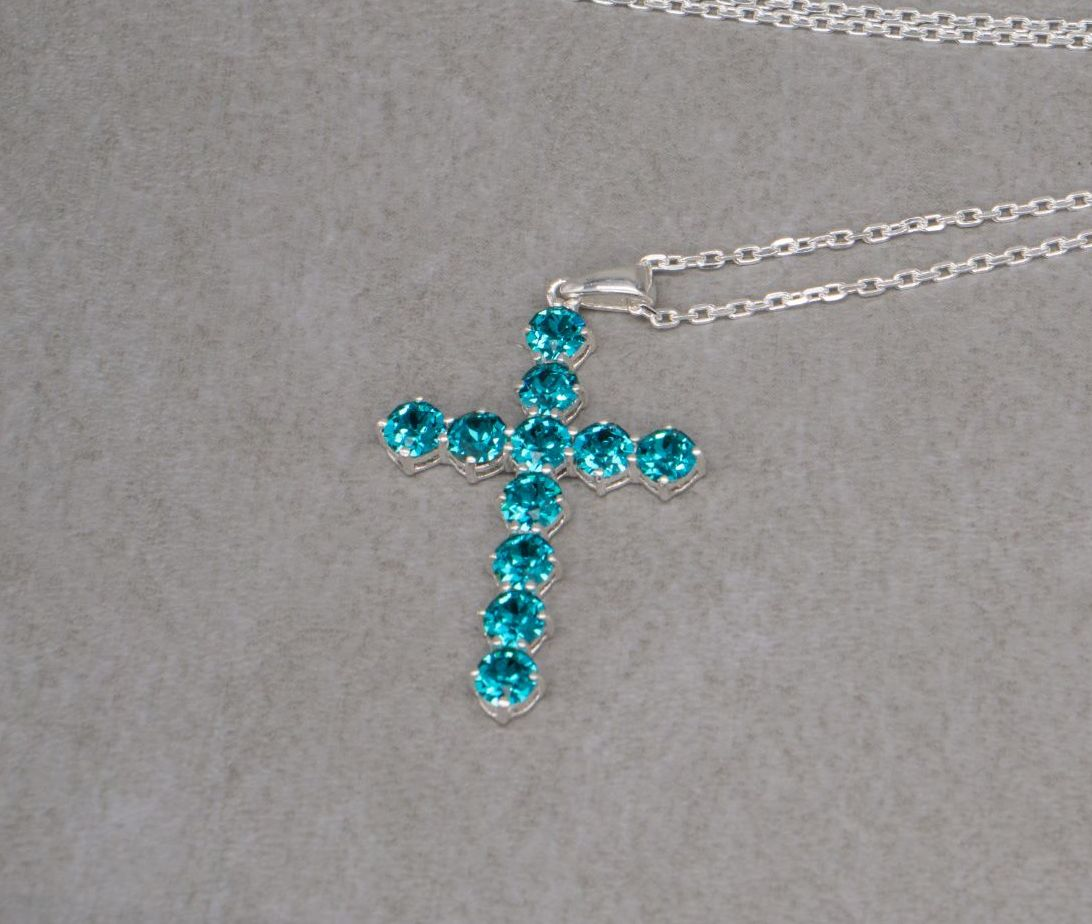 Sterling silver cross necklace set with teal / green Swarovski crystals