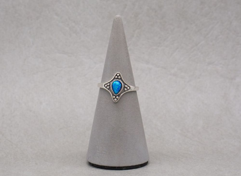 Unusual sterling silver & imitation blue opal ring