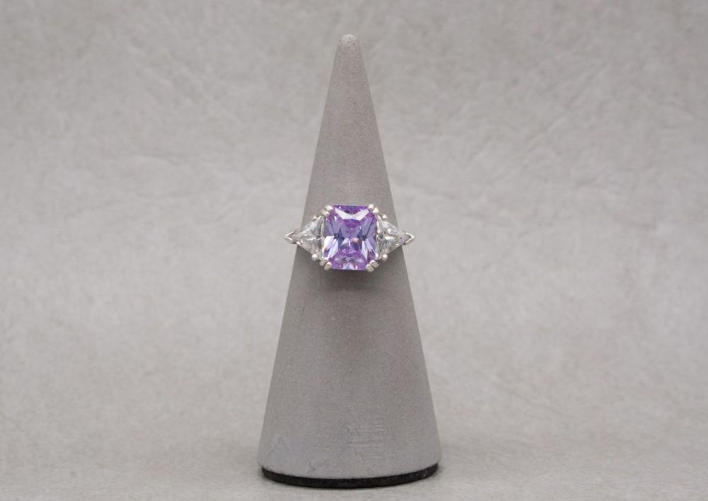 Sterling silver ring with a lilac rectangular cushion & 2 clear triangular