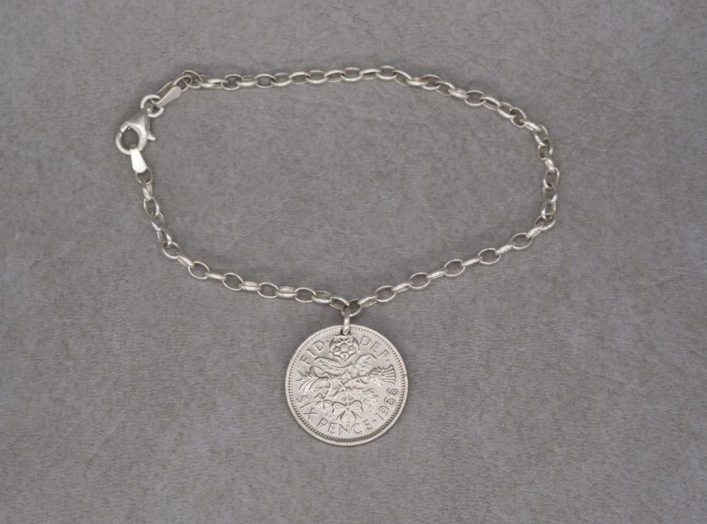 Sterling silver trace chain bracelet with a 1966 six pence coin