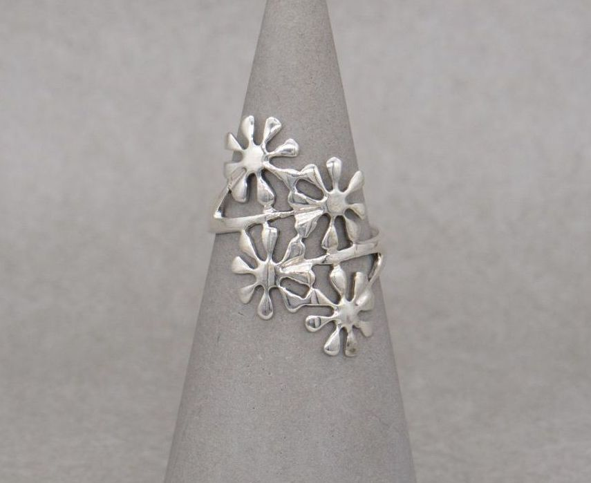 Long sterling silver flower bypass ring