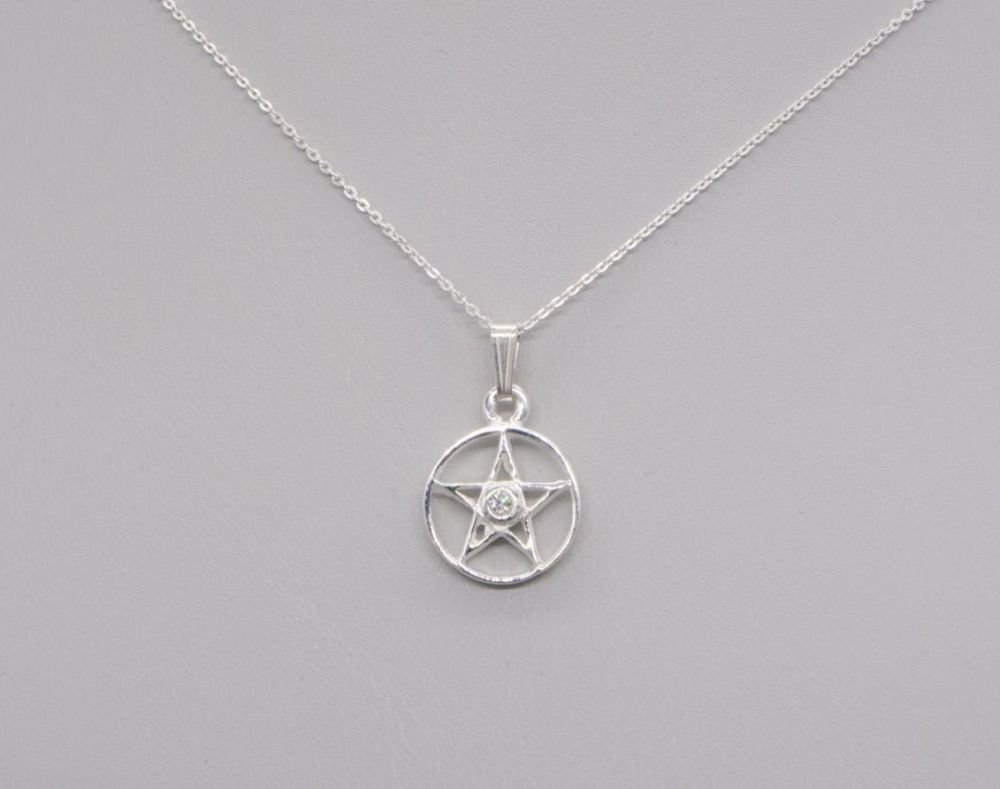 Small sterling silver pentagram necklace set with a clear stone