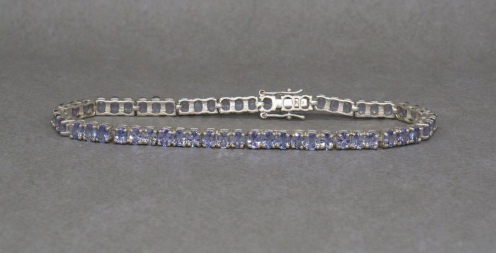 Sterling silver & pale amethyst tennis bracelet with safety catch