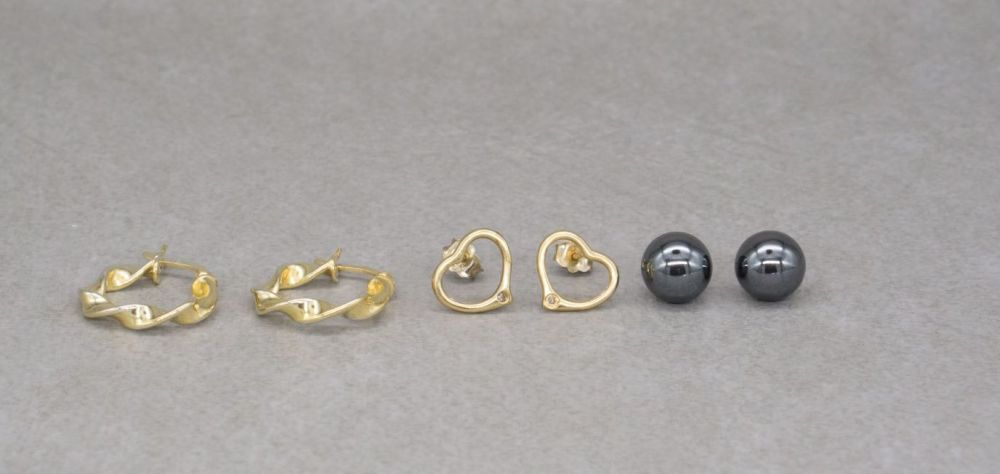 3 pairs of gilt sterling silver earrings; twist hoops, hematite sphere & open heart studs