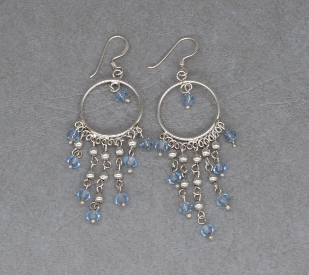 Sterling silver hoop earrings with blue bead fringe