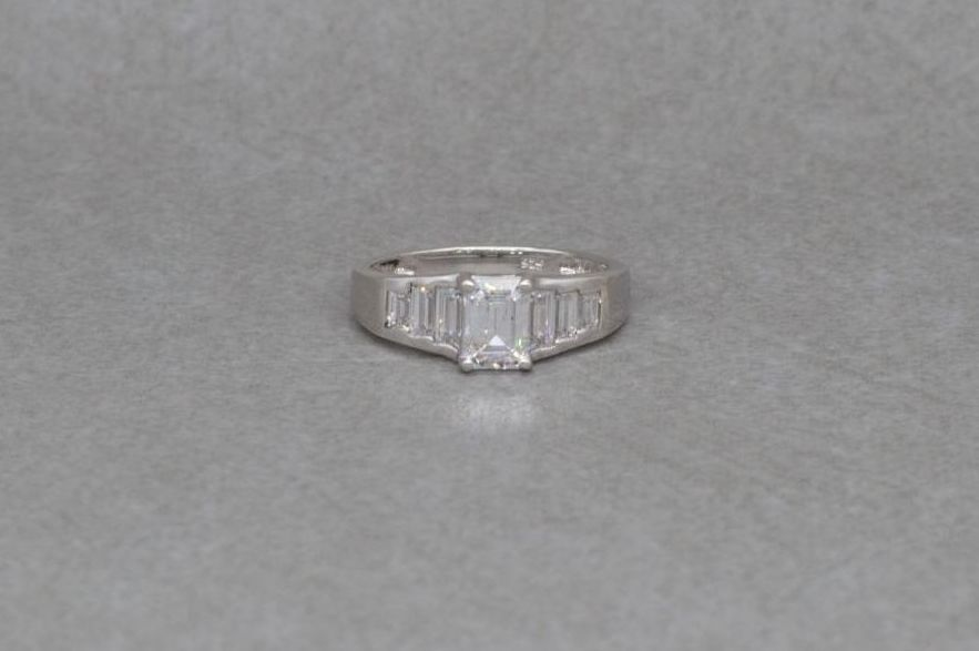 Sterling silver ring with graduated clear rectangular stones