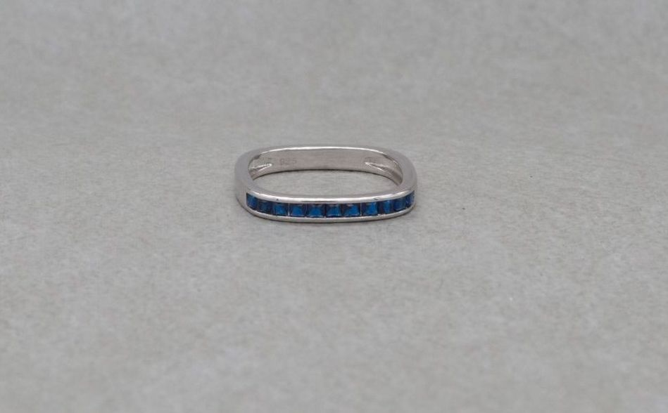 Unusual square sterling silver ring with deep blue stones
