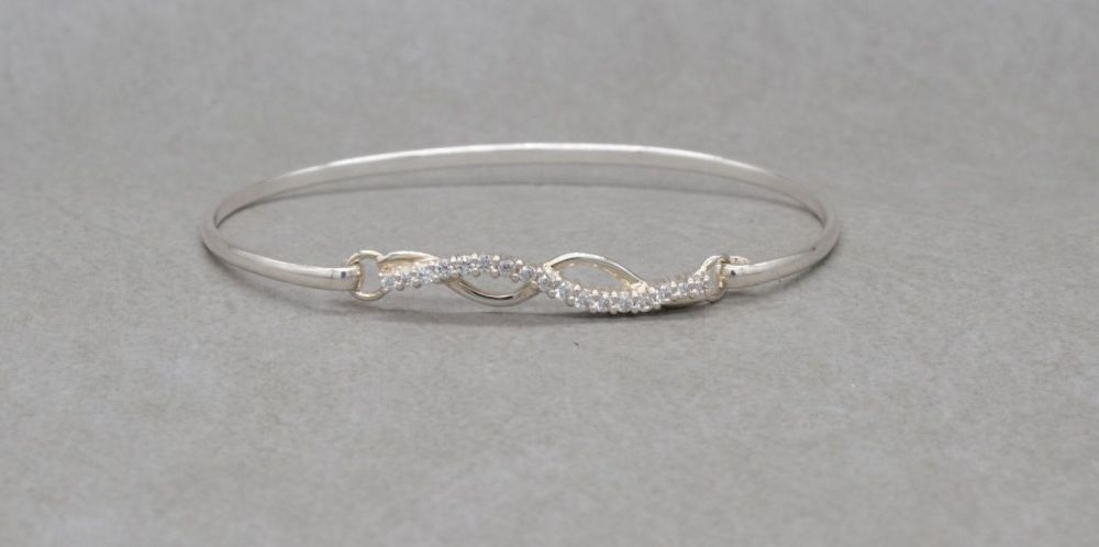 Sterling silver bangle with a stoned wave