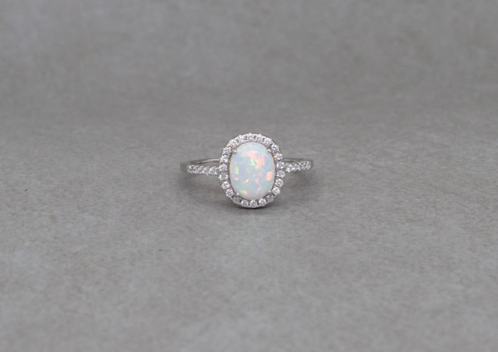 Sterling silver & imitation opal solitaire ring with accents
