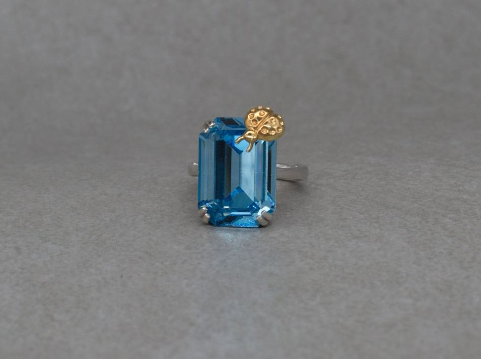 Unusual sterling silver & aquamarine Swarovski crystal ring with a golden ladybird