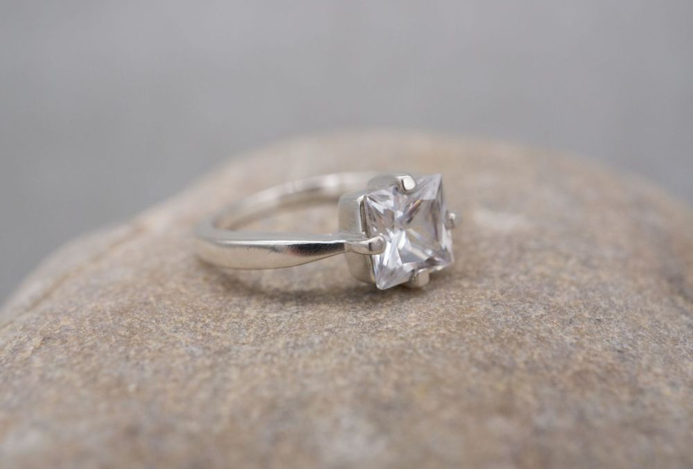 Square sterling silver solitaire ring with pinched shoulders