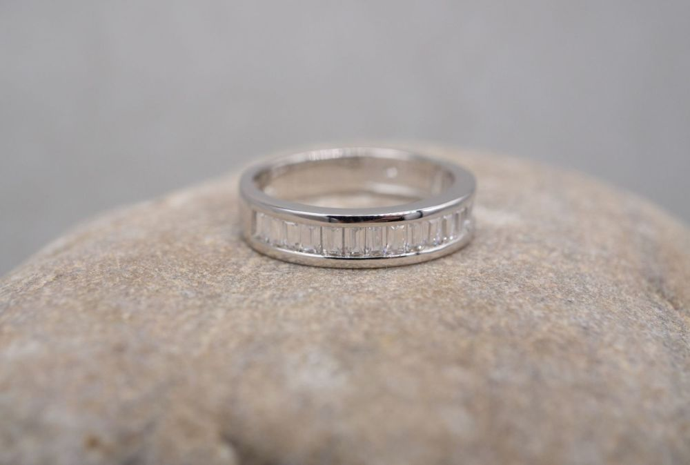 Sterling silver half eternity ring with clear baguette stones