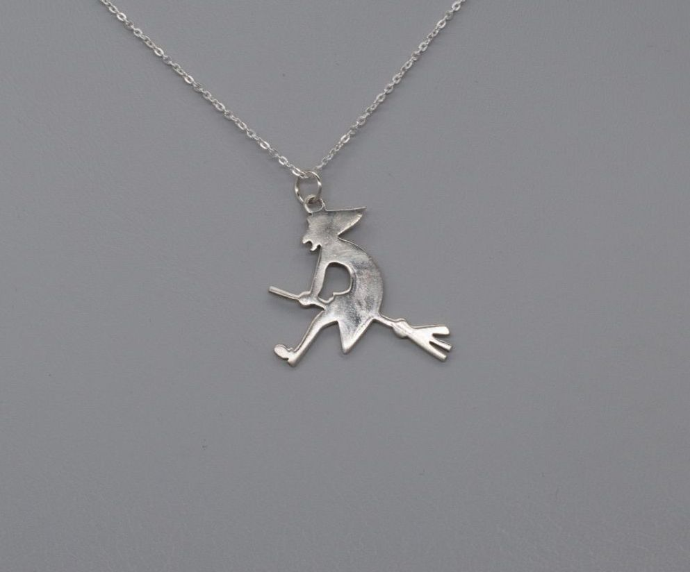 Sterling silver witch on a broomstick necklace