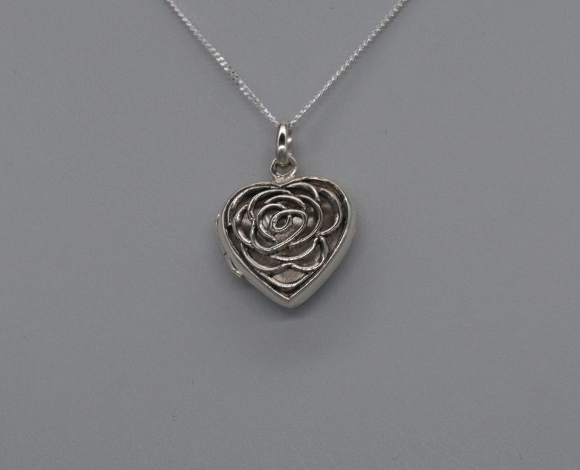 Sterling silver floral cut-out heart locket / necklace