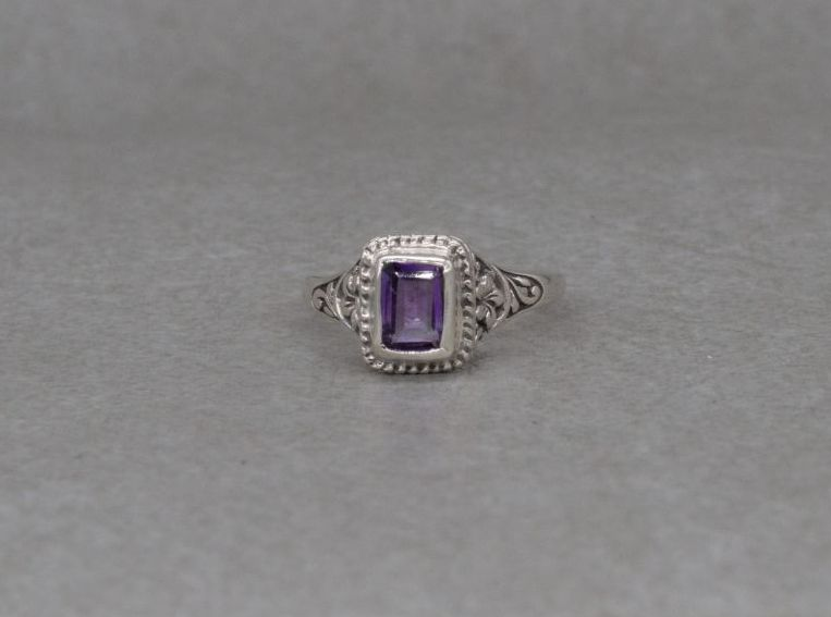 Sterling silver & amethyst ring with a floral mount