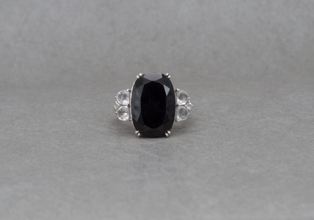 Substantial sterling silver ring with black & clear stones