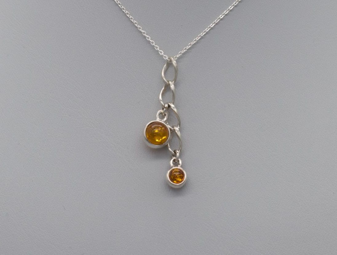 Sterling silver necklace with amber droppers