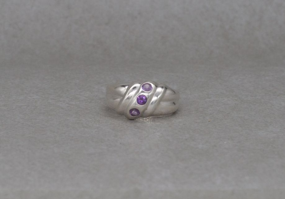 Sterling silver domed ring with purple stones