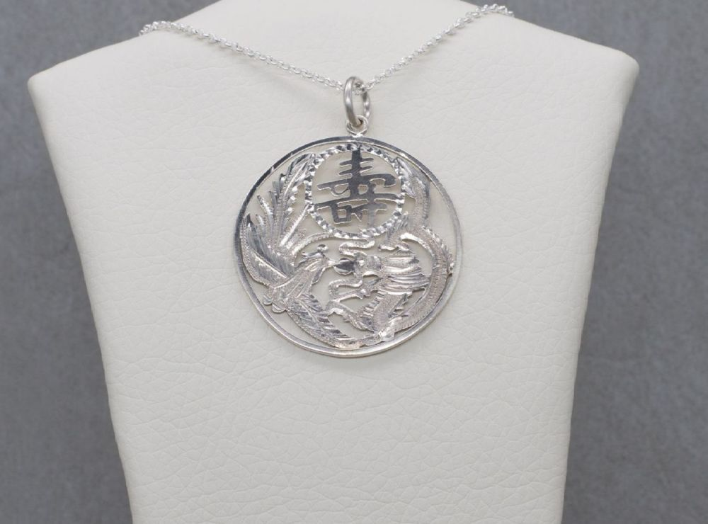 Large sterling silver oriental engraved necklace