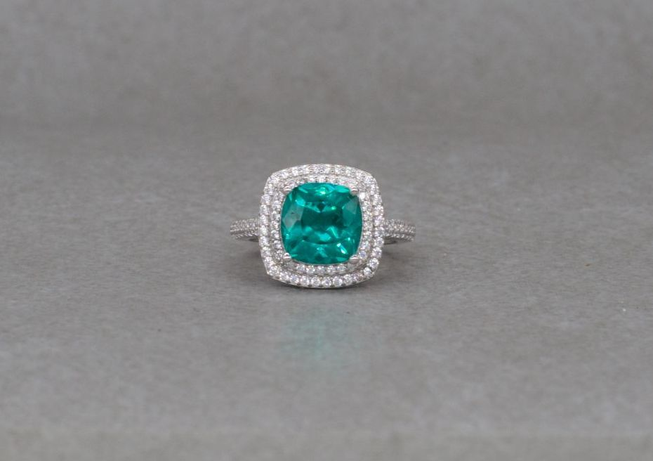 Sterling silver cocktail ring with a green cushion & clear accents