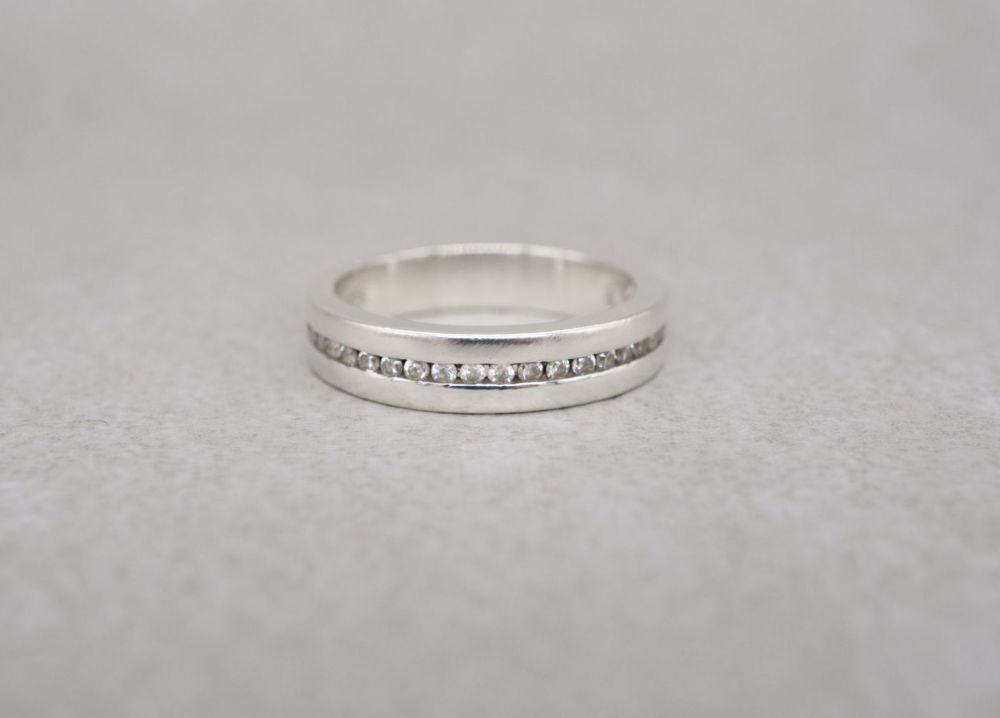 Thick set sterling silver & clear stone half eternity ring