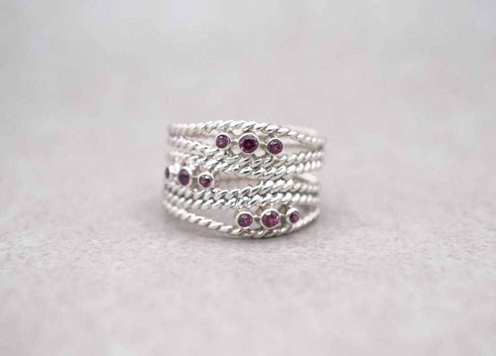 Wide sterling silver multi-band effect ring with deep pink stones