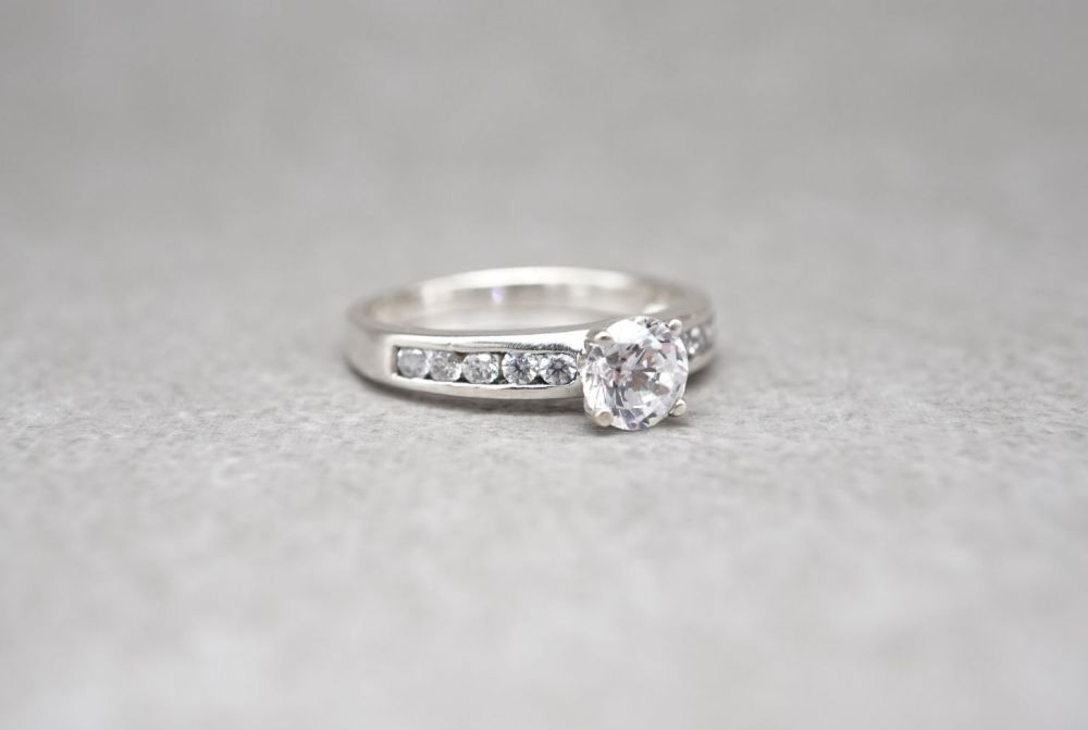 Sterling silver solitaire ring with accented shoulders