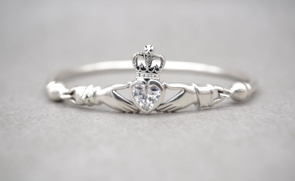 Sterling silver claddagh bangle with a clear stone heart
