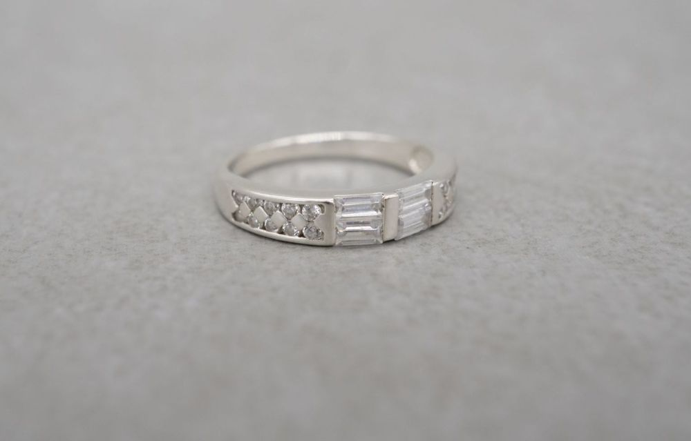 Slim sterling silver ring with multi-cut stones