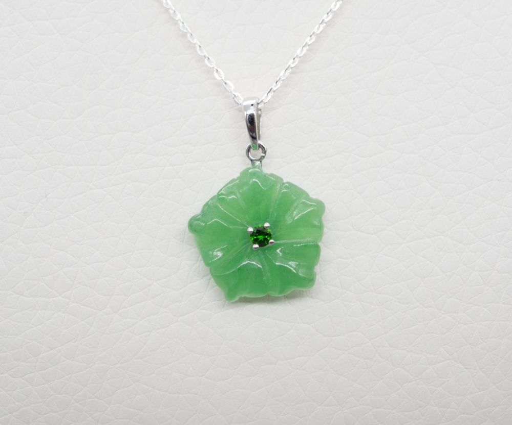 Sterling silver necklace with a carved green jade floral / flower head pend