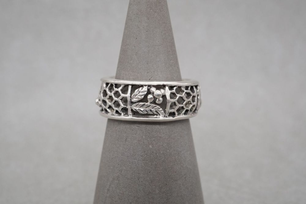 Handmade sterling silver ring with floral & honeycomb detail
