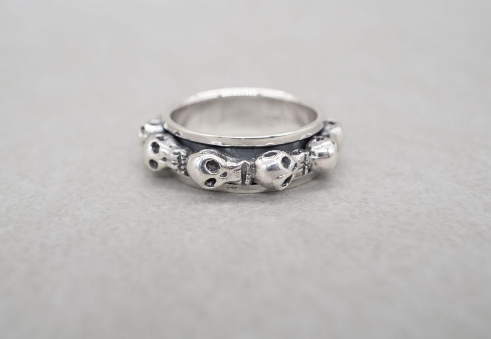 Unusual sterling silver skull spinner ring