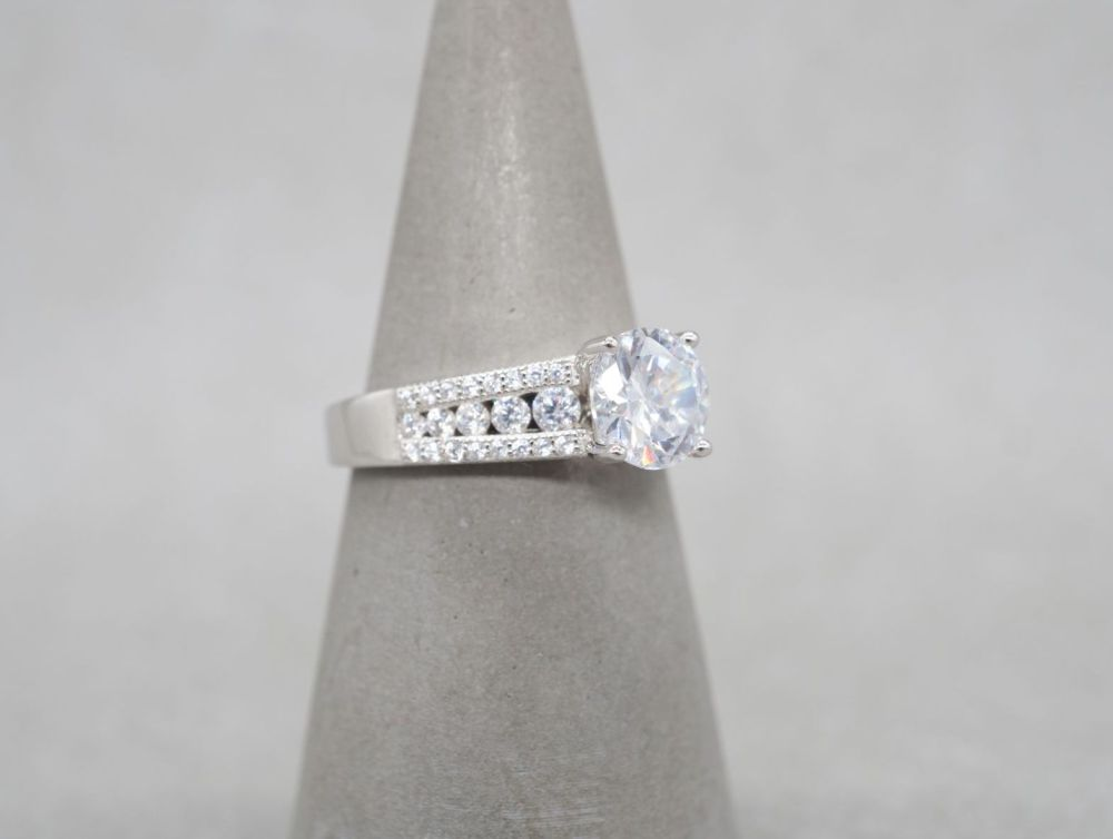 Elegant sterling silver accented solitaire ring