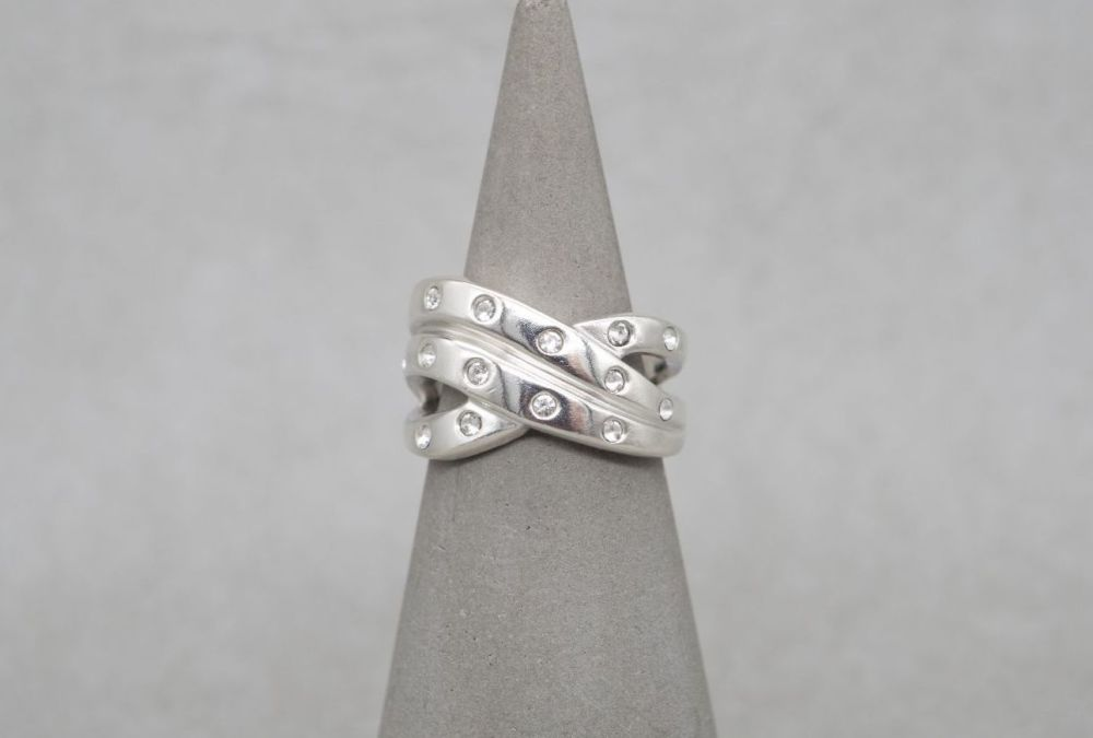 Chunky sterling silver cross-over ring with clear stones