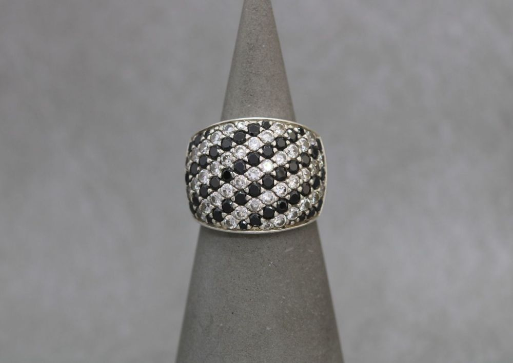 Wide sterling silver cocktail ring with black & clear stones