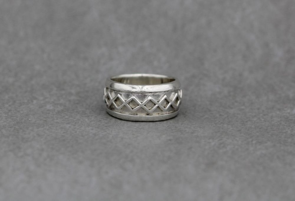 Sterling silver ring with a diamond pattern