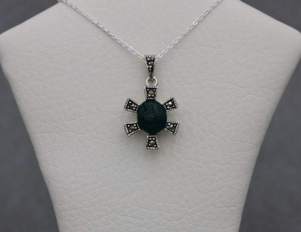 Small sterling silver necklace with a sun / star shaped marcasite & green pendant