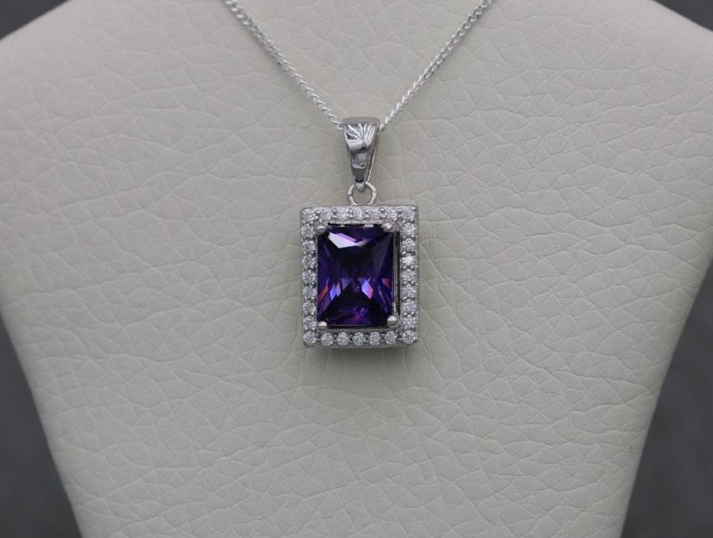 Sterling silver necklace with a rectangular purple & clear stone pendant