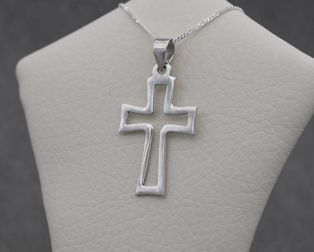 Unusual sterling silver outline cross necklace