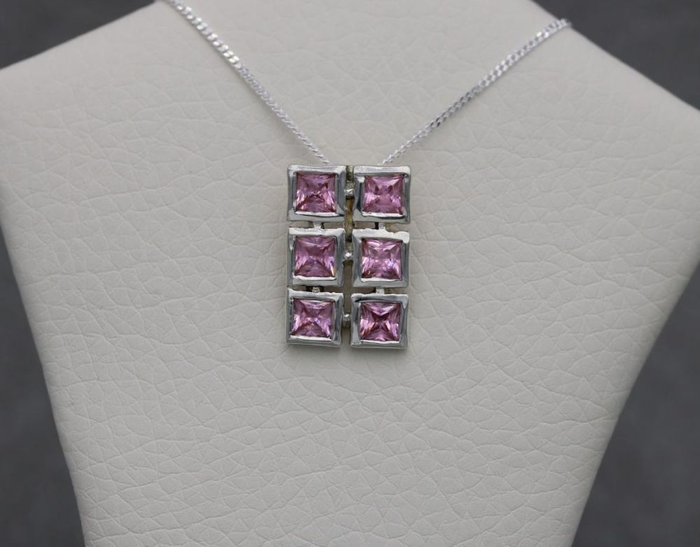 Sterling silver necklace with square pink stones