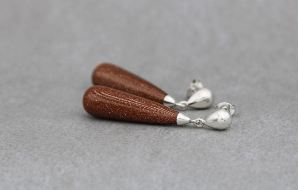 Long sterling silver & goldstone teardrop earrings