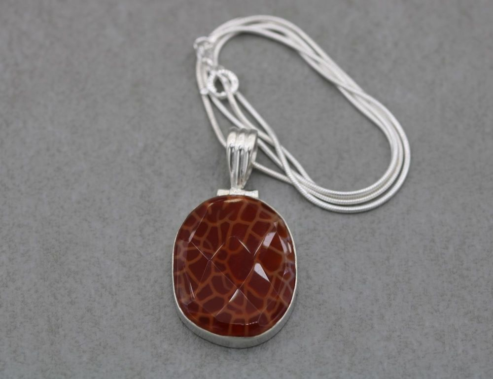 Unusual sterling silver necklace with a giraffe pattern faceted stone