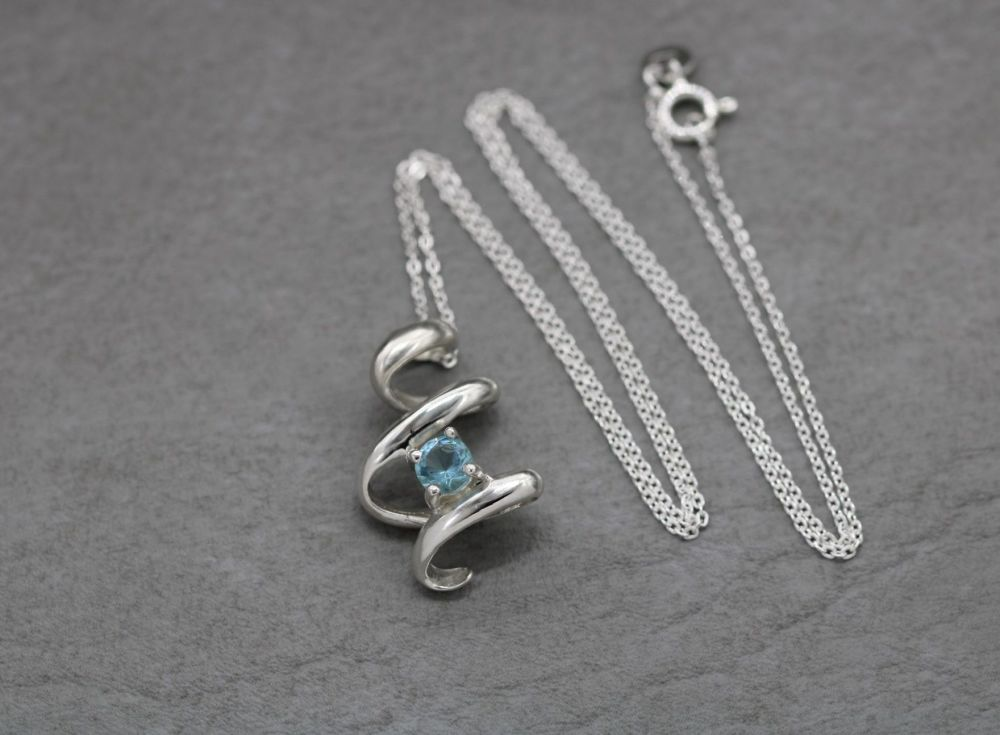 Sterling silver open twist necklace set with a blue stone