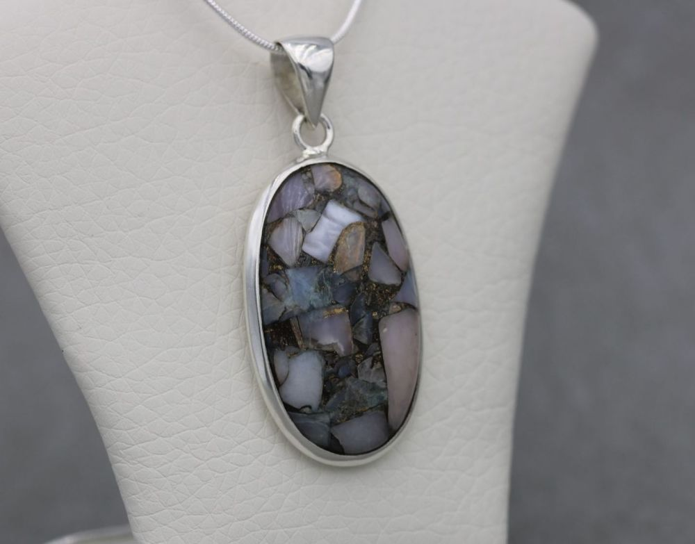 Sterling silver necklace with a mixed mosaic gemstone pendant