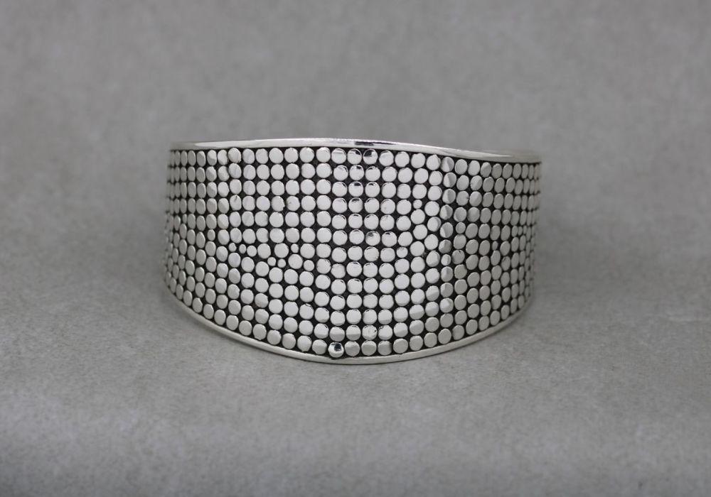 Graduated dotty textured sterling silver wrist cuff