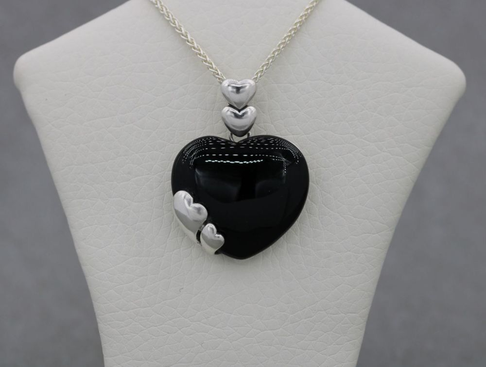 Sterling silver heart necklace with a black cabochon stone