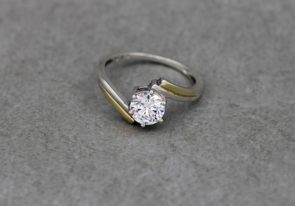 Sterling silver solitaire ring with gilt shoulder highlights