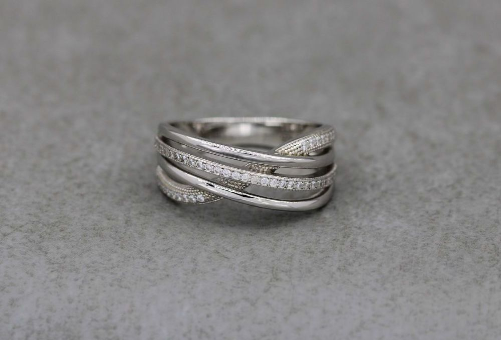 Elegant sterling silver multi-band effect ring with tiny clear stones