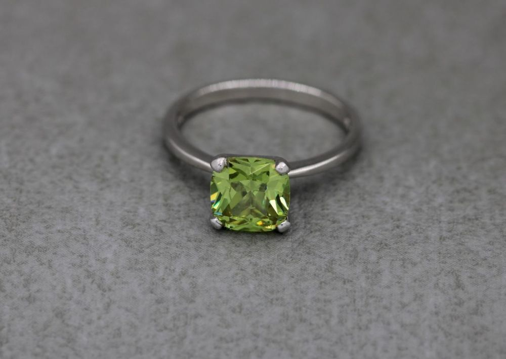 Proud set square sterling silver & yellowy green solitaire ring